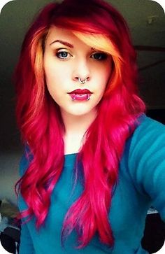 intense red hair with face framing blonde streaks. <3