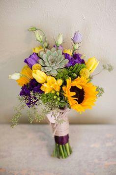Hand Tied Wedding Bouquet Arranged With: Yellow Sunflowers, Yellow Tulips, Yellow Freesia, Yellow Craspedia, Purple & Green Lisianthus & Buds, Green Succulents, Green Hypericum Green Eucalyptus Seeds + Green Foliage