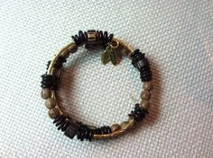 Wood shell and metal memory wire bracelet by StoneWireWorks
