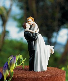 Love this cake topper. Much more romantic than just the bride and groom standing next to each other.