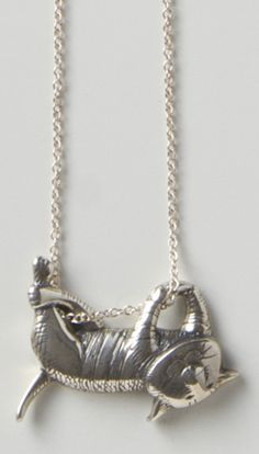 "Gorey Dangling Cat Necklace All his cats are cool, but this one by Edward Gorey (American, 1925–2000) is totally unflappable. Beautifully cast in sterling silver using the lost wax method, antiqued, and hand-finished. It was inspired from the cover illustration for Amphigorey. Made in the USA. Gorey studied at the School of the Art Institute in 1943. 17"" chain with 1/2"" x 1"" pendant."