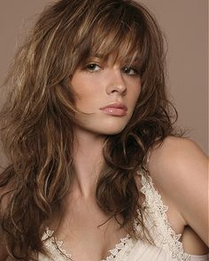 A long brown straight wavy shaggy hairstyle by Royston Blythe