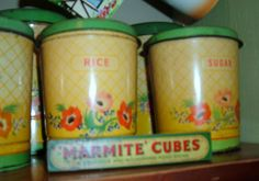 Handiware tins by the vintage cottage, via Flickr