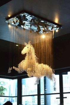 horse chandelier- holy cow, AWESOME!! Too much for a dining room?