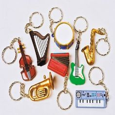 Musical Instrument Key Chains --- http://www.amazon.com/US-Toy-Musical-Instrument-Chains/dp/B0087QI77W/ref=sr_1_62/?tag=affpicntip-20