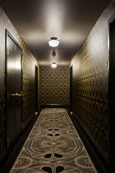Hall corridor custom wallpaper and carpets by Nicole Hollis at the Palladian Hotel, Seattle -- Lonny.com