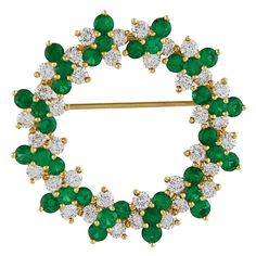 Tiffany & Co. Brillant Emerald and Diamond Brooch. 18K set with 3ct of emeralds and 2.75.ct of full cut diamonds. circa 1990s