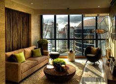 http://www.dickoatts.com/wp-content/uploads/2013/02/Zen-Look-Brown-Couch-Cream-Rug-Wide-Windows.jpg