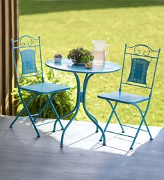 Cute little outdoor table and chairs. Nice teal color, great for balconies and small patios!
