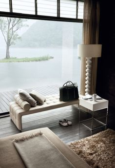 white bedsite table used in the livingroom combined with white bench beautiful lamp sof rug and cream sofa