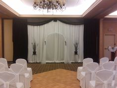All of the focus will be on you with this ceremony backdrop, simple yet elegant.