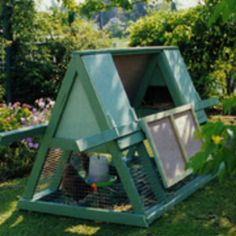 great how-to chicken tractor. Or maybe its not a tractor. It has a screen floor but chickens can peck the grasses that come through the screen. I love the idea, and the color.