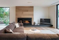 ▷ Tpps, how to make your home after Feng Shui - feng shui living room, fireplace, brown corner sofa, round coffee table - Home Fireplace, Modern Fireplace, Living Room With Fireplace, New Living Room, Fireplace Design, Home And Living, Living Room Decor, Contemporary Fireplaces, Brown Corner Sofas