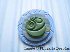 Polymer clay brooch.