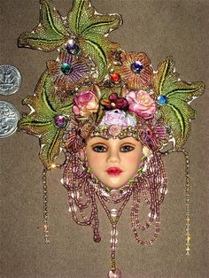 A small sculpted face, decorated. Beaded Brooch, Beaded Jewelry, Handmade Jewelry, Jewellery, Doll Head, Doll Face, Paint Brush Art, Clay Faces, Beaded Embroidery