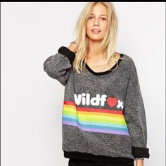 """Wildfox """"Dreams Come True"""" BBJ Grey Size L NWT Wildfox Couture Grey """"Dreams Come True"""" baggy beach jumper, size Large. This does not have a V-neck line, it was hard to find a stock photo. The front has 'Wildfox' written in white and a rainbow, both have a slight """"puffy"""" feel to them. If you have any questions please ask prior to purchasing    ✨No Trades/PP✨ PLEASE NOTE: the jumper for sale does NOT have the black banding around the neckline/sleeves Wildfox Sweaters"""