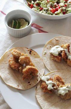 shrimp tacos with avocado crema and slaw
