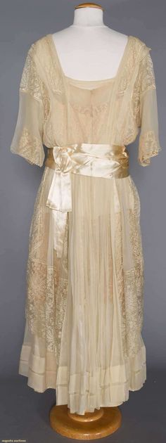 My Pompadour Isn't Listening., WHITE SILK & LACE EVENING GOWN, c. 1914  Source