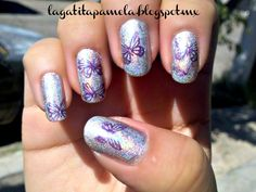 butterfly over silver holografic nails