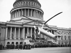 The postal worker who landed at the Capitol wasn't the first. (It wasn't even the first gyro.) On April 28, 1936, a Kellett KD-1 autogiro hopped over the Capitol Dome and touched down to a warm welcome in the parking lot on the East Front of the Capitol. (Library of Congress)