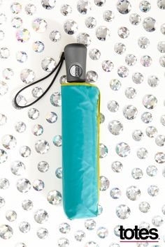Get your glitz on. Stay dry and fashionable with totes super tough, super cute Titan umbrellas. #totesraingear