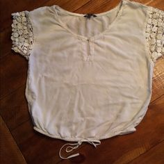American Eagle Lace Sleeve Top American Eagle Lace Sleeve Top with drawstring tie waist. Sleeves are a crocheted lace. 100% cotton minimal wear. American Eagle Outfitters Tops