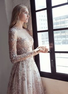 Fall in love with the Lee Petra Grebenau wedding dress collection. An Israeli bridal designer creating gorgeous gowns with breathtaking silhouettes Wedding Dress Sleeves, Long Wedding Dresses, Long Sleeve Wedding, Sheer Wedding Dress, Long Sleeve Bridal Dresses, Long Sleeve Gown, Applique Wedding Dress, Bridal Collection, Dress Collection