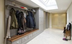 Grey Boot Room with lovely drawers under the bench and closed closets.