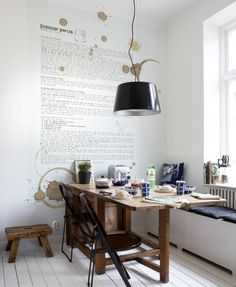 I like the writing on the wall.  I like the idea of doing this but without stencils