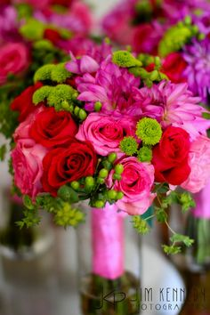 vases/centerpieces ~ bright, beautiful colored flowers