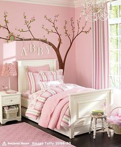 Love the tree and the name hanging from the branches.  The whole effect is a LOT of pink - maybe switch the bedding out for creams and whites so it's not so overwhelming?