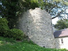 WALES – Cardigan Castle - The truncated and partially buried east tower. The arrow loop opens from one of two flights of stairs that lead down to forward facing guardrobe chambers.