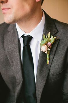 succulent + flower bud boutonniere, photo by Inkspot Photography http://ruffledblog.com/mexican-ranch-wedding-ideas #grooms #boutonnieres