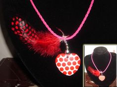 red heart with red feather necklace