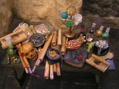 Wizard's paraphenalia in miniature by Oberonswood on etsy.