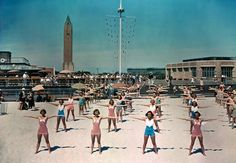 Free calisthenics lessons are given daily for beach visitors in Long Island, New York, 1939.