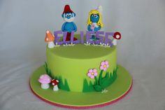 https://flic.kr/p/a1YB9U   Elliese's Smurfs Cake   I enjoyed making Papa smurf and Smurfette but I wished the client opted for the 3D mushroom instead :(