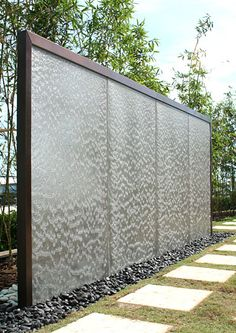Water Studio. Stainless stell screen, copper with broze patina frame. Project by RBS Architects & Town Planners.