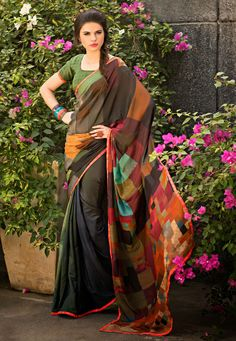 Spruce up your #Ethnic wardrobe by adding this Black Color Faux Georgette #DesignerSaree which is accompanied with a matching Blouse Piece. The saree flaunts attractive geometrical prints and a contrasting lace embellished border.