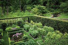 Cut flower and fruit garden enclosed within an eight-foot-high clipped hornbeam hedge. The interior is composed of granite cobblestone-edged beds planted with raspberries, currents, iris, alliums and lilies. Design by Madison Cox. Photo by Oberto Gili. From www.online.wsj.com.