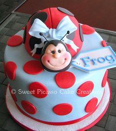 lady bug on blue cake
