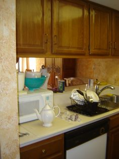 The kitchen BEFORE we renovated. Now, the cook's not cut off from the company and the view, there is more counterspace to work and all new appliances. Oh and the sponge painting is gone, baby, gone! Florida Sunshine, Condo Interior, Sponge Painting, Kitchen Cabinets, Appliances, Relax, Vacation, Cooking, Baby
