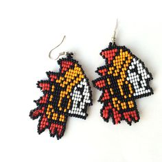 """This bold pair of earrings comes from an Embera Chami settlement, a widespread tribe originating in the Choco region, Colombia. They are inspired in a """"jaibana"""", the spiritual leader of the community,"""