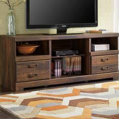 Features:  -Material: Laminated MDF and particleboard.  -Outdoor use: No.  Finish: -Century Barn Pine.  Product Type: -TV Stand.  Pieces Included: -N/A.  Cabinets Included: -Yes.  Hardware Material: -