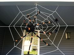 A Tangled Web - step by step guide to creating the perfect spider web decoration for Halloween. Your house will be the coolest house on the block!