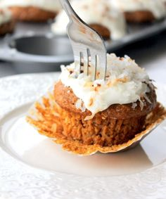 Healthy Morning Glory Muffins packed with carrots, coconut, walnuts, raisins, and whole grains!