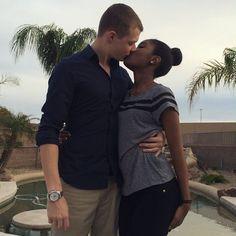 Black girl and white guy kissing