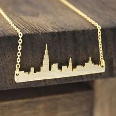 New York Skyline Necklace(Gold) Put on this necklace and keep an Empire State of mind. This is the story between you and your city.                                                                         High Quality Silver plated stainless steel! This is NOT made out of zinc alloy which can easily cause itchiness and rashes on skin.                                                             Super shinny exquisite and well made!                     Comes in a Gift Box!❣See my other listing…