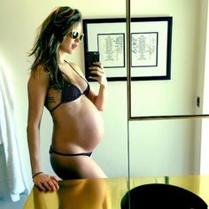 """Behati Prinsloo's chicest pregnancy looks: Decked out in a black bikini, Prinsloo shared another bump selfie with the caption, """"34 weeks """" on Instagram."""
