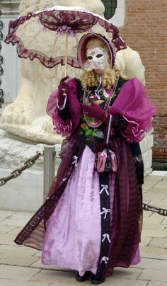 https://flic.kr/p/7Fbagm | Curly blond in purple (P1000310a) | I went to to the 2010 Carnevale in Venice, Italy - what an absolute blast! I had the chance to shoot with an incredible number of people in gorgeous costumes and masks - it was a great experience and I'm already looking forward to going back there again.  I took this photo near the Arsenale in Venice on Tuesday, 9 Feb 2010.